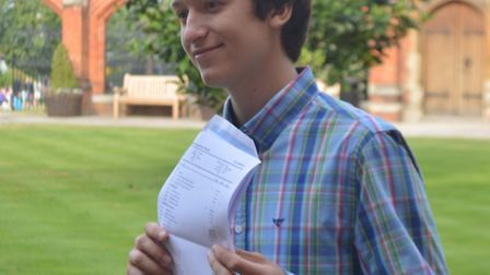 Peter Andreev, 17, who got six A*s and one A, celebrates his A-level results at Bancroft's.