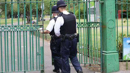 Police lock the gates to Loxford Park, the scene where an 11-year-old boy became the victim of a sho