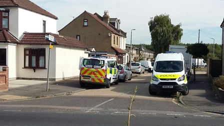 Police outside the home in Rainham Road, Rainham, earlier today. Photo: MPS Havering