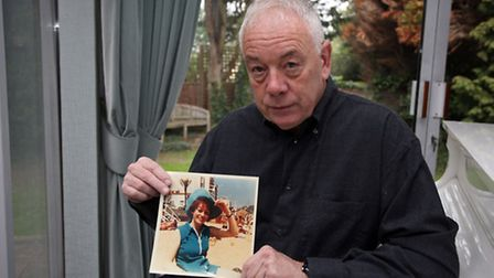 Bernard Bloom with a picture of his sister Carmel Bloom.