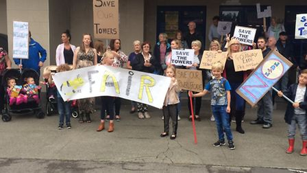 About 80 people gathered outside the former Towers Cinema.