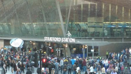 The man held his arms up at one part during the incident at Stratford train station. Picture: Daniel
