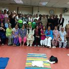 The 46-strong yoga class at Ilford's Punjabi Centre raised £240 for Macmillan Cancer Support.