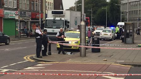 Police cordoning off part of High Street, Barkingside, after a stabbing this morning. Photo credit: