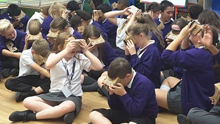 Pupils at Elm Park Primary School using the contraption.