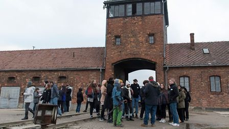Students gathered at the main entrance to Auschwitz II (Birkenau). Picture: grahamsimages.com