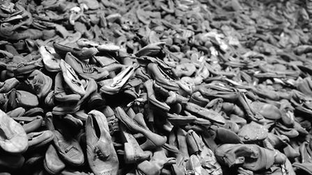 Piles of shoes taken from Jewish prisoners at Auschwitz. Picture: Owen Humphreys/PA