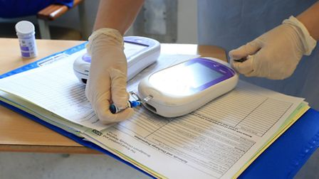 File photo dated 03/10/14 of a nurse gives a patient a diabetes test, as three-quarters of older chi
