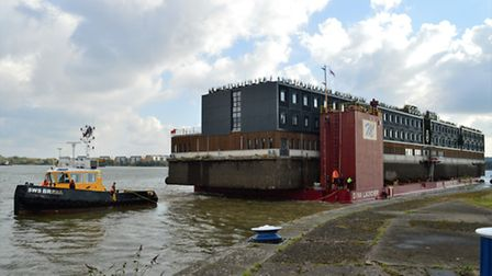 The Good Hotel is towed into the Royal Docks on Friday. Picture: Andrew Christy, @AJBC_1
