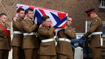 The coffin of Private Harry Carter of the 10th Battalion Essex Regiment being carried by serving sol