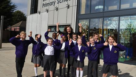 The Headteacher of Elm Park Primary School Victoria Morris celebrating with pupils after a good rati