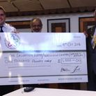 A cheque for £1,000 is presented to Lt John Clifton from Ilford Salvation Army by Redbridge Mayor Cl