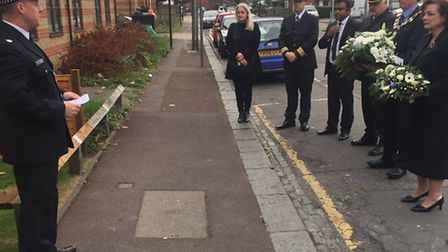 Flowers are placed by service attendees. Picture: Newham MPS