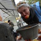 Market Place, Romford. Apple Day event. Event co-ordinator Ellie Gill demonstrates the art of Apple
