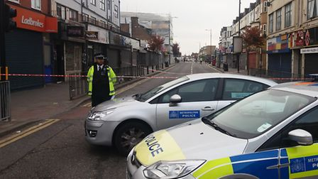 Police at the scene of a stabbing which happened after midnight in Goodmayes Road, Goodmayes. Pictur