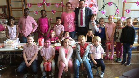 Pupils from Harold Court Primary School dressed in pink to help raise £950 for charity.