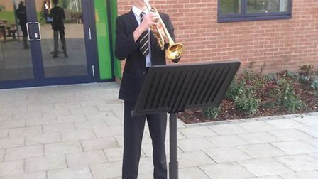 Will Clifton, 12, playing the Last Post on Armistice Day at Woodbridge High School.