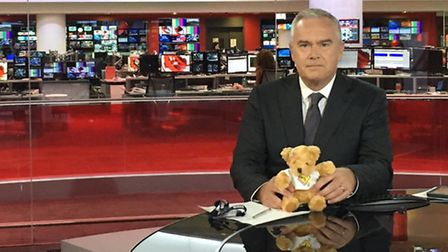 Huw Edwards with Kaleigh's bear in the BBC studios.