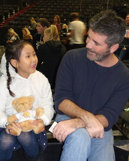 Kaleigh with X Factor judge Simon Cowell.