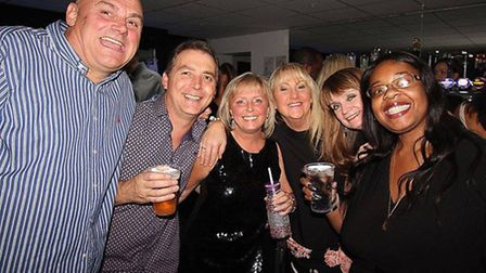 A group posing for a picture at a previous Ilford Palais reunion night. Picture: John Wayne