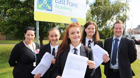 East Point Academy pupils Jess Daniels, Lorna Woodward and Sophie Rayner with teaching staff Don Mar