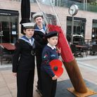 Sea cadets from Hornchurch and Upminster unit S Hurricane at the exhibit for the fallen soldier in C