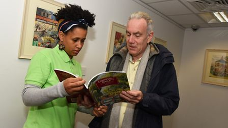 Staff volunteer Elisabete Lopes with visitor Martin Bates at the Changing Face of Forest Gate exhibi
