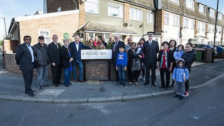 Cllrs Ken Clark and Forhad Hussain help unveil a sign in Young Road paying tribute to World Speedway