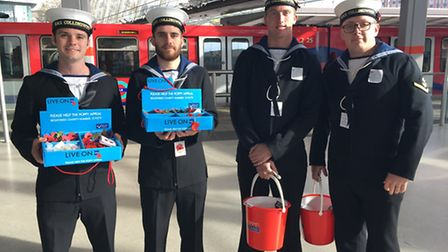 LAC James Lighten, right, with other sailors from HMS Collingwood who have been selling poppies in S