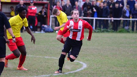 A Clapton player waits for the ball to drop in midfield (pic Tim Edwards)