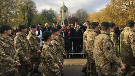 Mayor of Newham Sir Robin Wales watches as cadets march by
