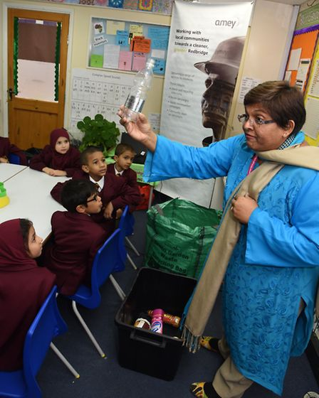 Habiba Ahmed demonstrates the importance of recycling to children at the Read Academy in Ilford.