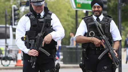 Armed policemen on patrol. Photo: Jonathan Brady/PA Wire/PA Images.