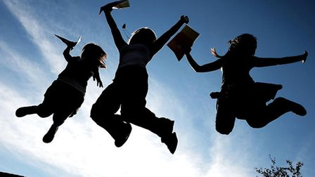 Pupils jumping for joy. Picture: Owen Humphreys/PA Wire/PA Photos