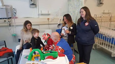 Children at Queen's Hospital enjoying some of donations from customers.