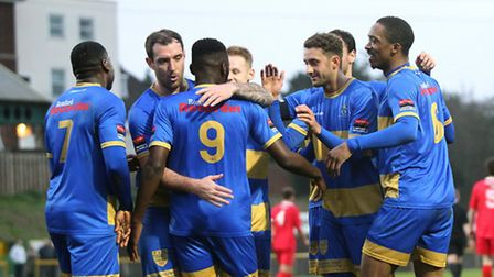 Romford's Nick Reynolds congratulates Chinedu McKenzie (9) on one of his three goals against Wroxham