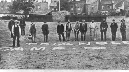 """Men standing on the waste ground which became known as """"Triangle Camp"""" with Cunningham on the left w"""