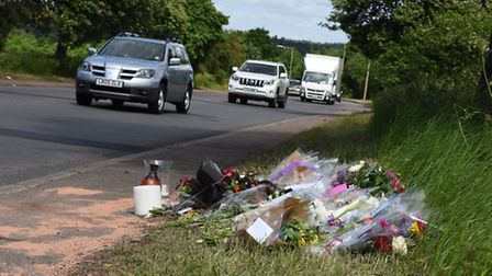 Floral tributes on Chigwell Rise for jogger Alex Weatherley who was run down and killed by a driver.