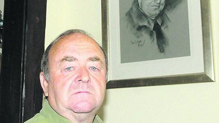 Les Balkwell stood below a picture of his son Lee.