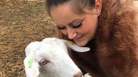 Sammie Aubrey with a goat at Wellgate Farm that is believed to have gone to slaughter. Photo: Tracy