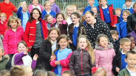 Excited youngsters are surprised when a Sea King helicopter arrives on their school grounds.