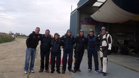 The Southwold firefighters prepare for the skydive. From left to right are Daniel Ripken, Carl Bedfo