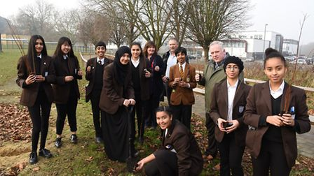 Pupils at Beal High School planting trees as part of their environmental campaign with Principal Ter
