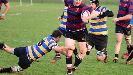 An Upminster player tries to tackle a rival (pic Tim Edwards)