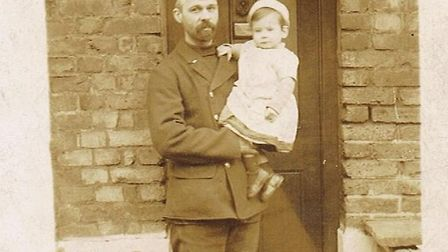 Fireman Frederick Sell with his youngest son Sydney outside the family home, one of the firemen's co