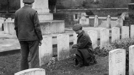 Soldiers inspect graves at the South African First World War cemetery at Delville Wood, 13 November