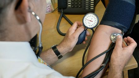 A GP checking a patient's blood pressure. Photo: Anthony Devlin/PA Wire/PA Images