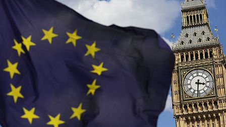 The European Union flag in front of Big Ben, as MPs get set to make their final votes on the Brexit