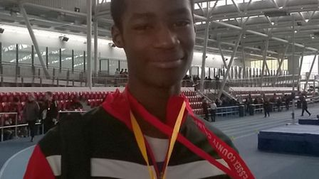 Havering's Shandell Taylor shows off his medal (pic Tony Benton)