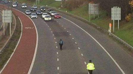 Isabelle Anderson is chased by a policewoman after walking onto the M4. Picture: Rachel Venables, LB